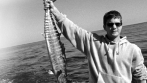 Pacey Witter displays a large fish creature.