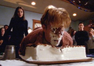 Dawson puts his face in the cake