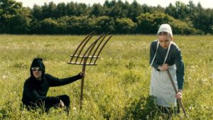 David in a field with an amish.